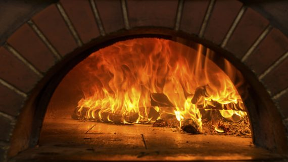 Fire wood burning in pizza oven